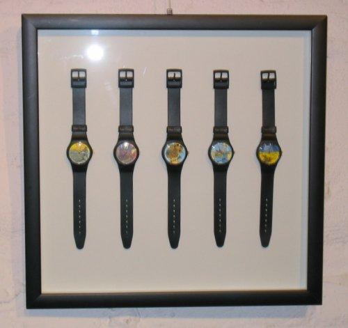 Einrahmung einer kleinen Uhrensammlung